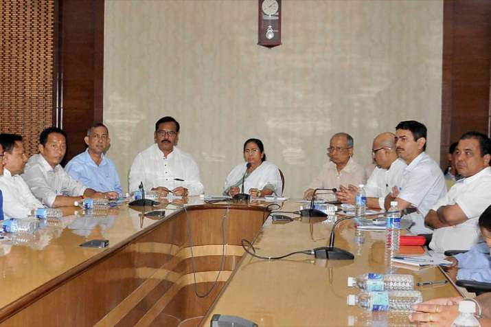 West Bengal Chief Minister Mamata Banerjee holding an all