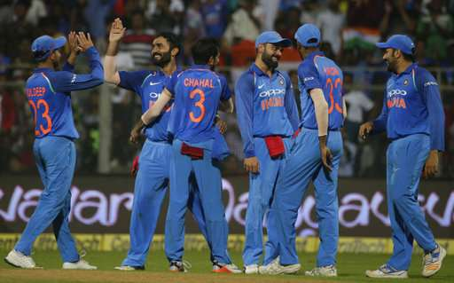 Indian cricket team players celebrating the fall of New