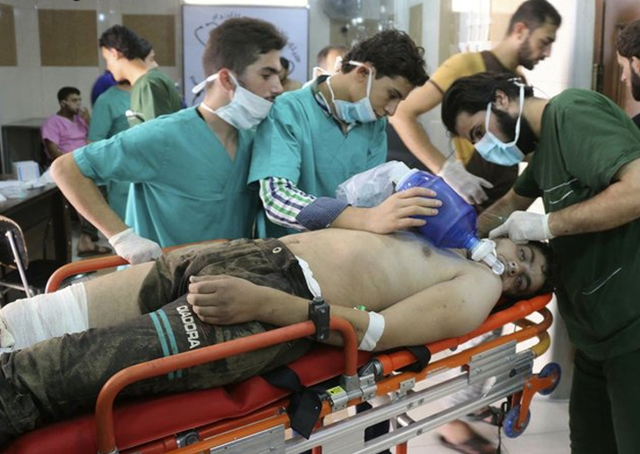 File pic - Medical staff treating a man suffering from