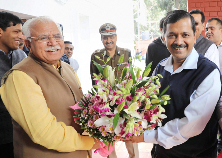 Manohar Lal greets Arvind Kejriwal before a meeting in