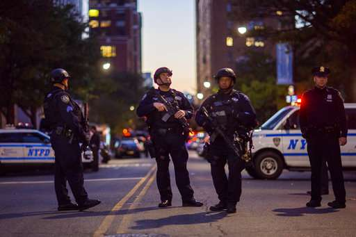 India Tv- Heavily armed police stand guard near the scene after a motorist drove onto a busy bicycle path near the World Trade Center memorial and struck several people