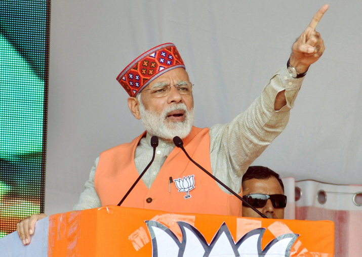 Narendra Modi addresses an election campaign rally in