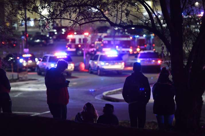 India Tv - People watch police activity at the scene of a shooting inside Walmart in Thornton
