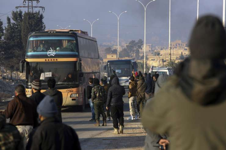 A bus carrying evacuees from Aleppo arrive at a refugee camp