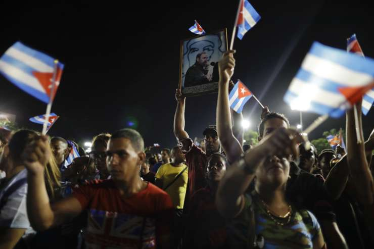 People wave Cuban flag during a rally to pay respects to Fidel Castro