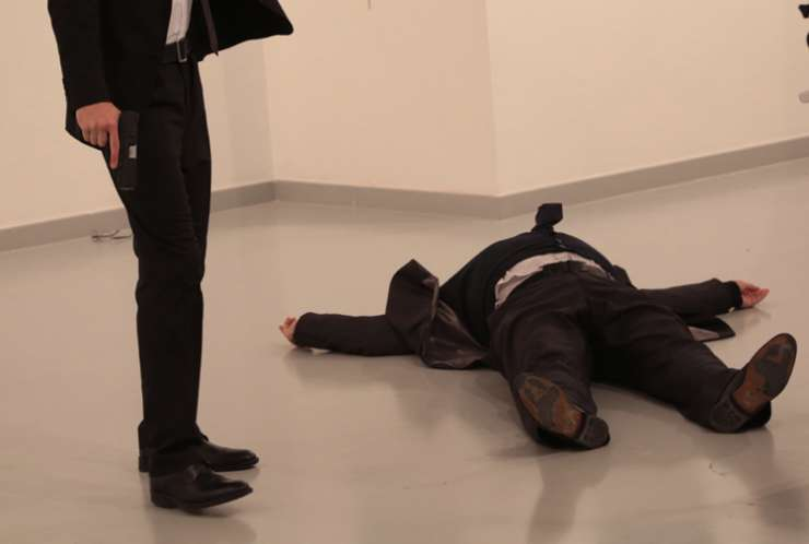 Russian Ambassador to Turkey, Andrei Karlov, on the ground after being shot