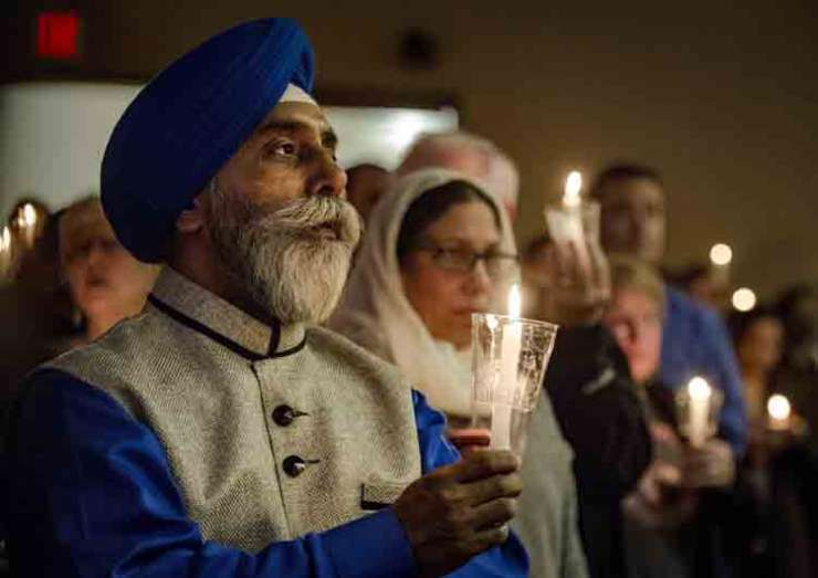 People in prayer vigil for Indian engineer, killed in a bar shooting incident
