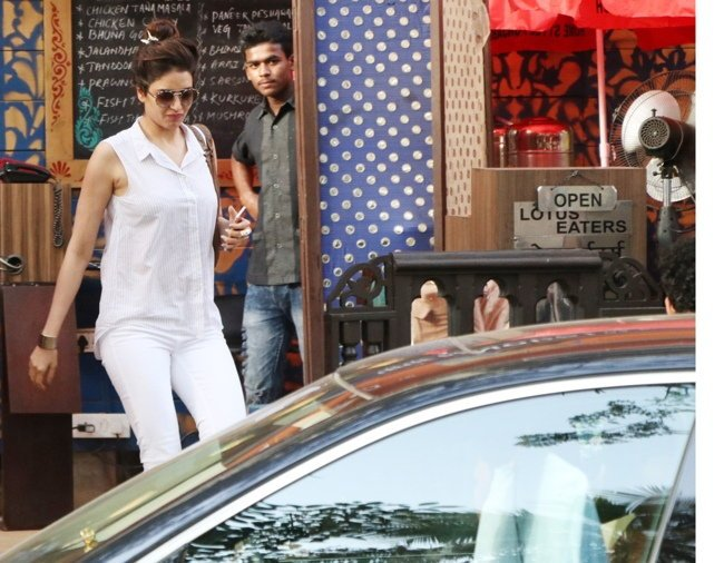 Karishma was dressed in simple white shirt and denim.