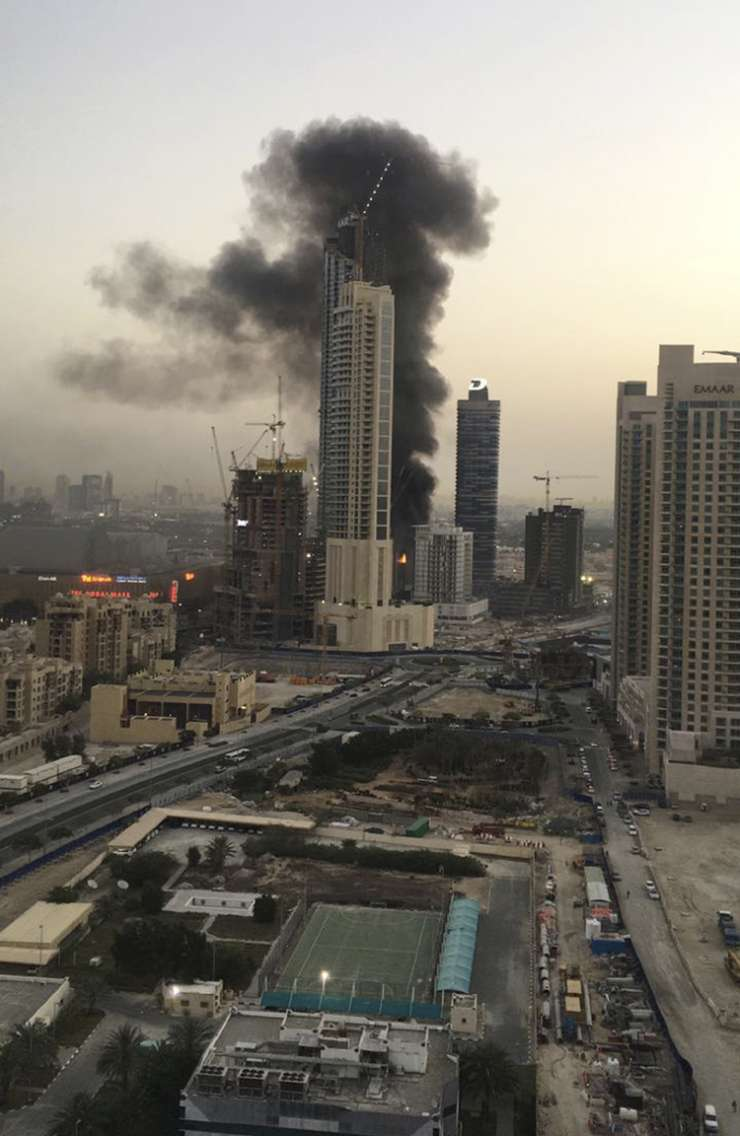 India Tv - Smoke rises from a fire at a construction site next to Dubai Mall