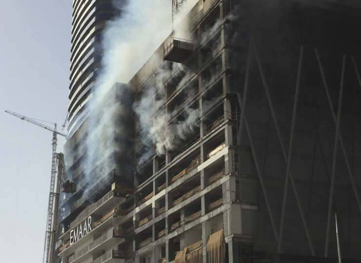 India Tv - Firefighters battle a blaze at an under-construction tower in Dubai
