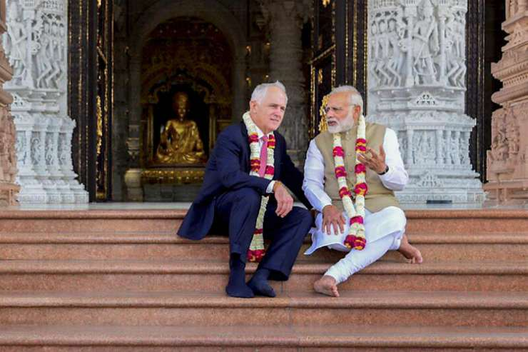 India Tv - Modi and Turnbull during their visit to the Akshardham Temple