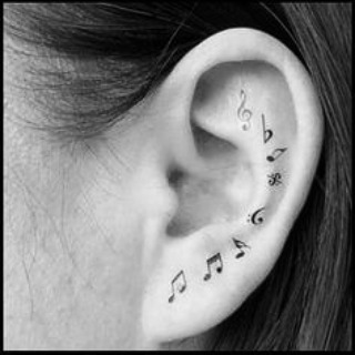 India Tv - musical notes tattoo