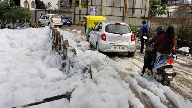 India TV - After delightful showers, Bengalureans struggle with 'chemical snowfall'