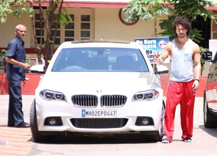 India Tv - Tiger Shroff with his white BMW 5 series