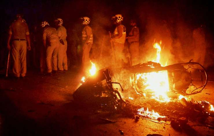 A bike in flames after clash between police and students at BHU on Saturday