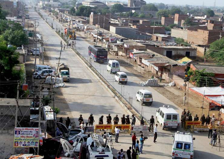 Vehicles of the search team move towards Dera HQs on second day of ops