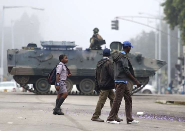 An armed soldier patrols a street in Harare on Wednesday