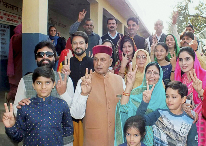 Prem Kumar Dhumal, his son and MP Anurag Thakur along with other family members after they cast their vote at a polling booth in Hamirpur
