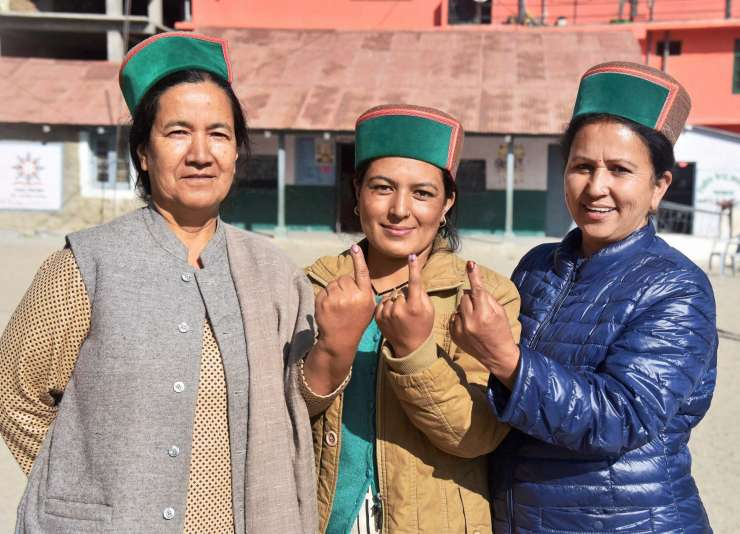 A group of women show their inked finger after they cast their vote for the state's Assembly elections. PTI photo