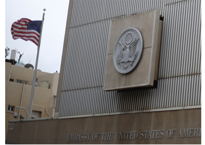 The American flag flies at the US embassy building in Tel Aviv