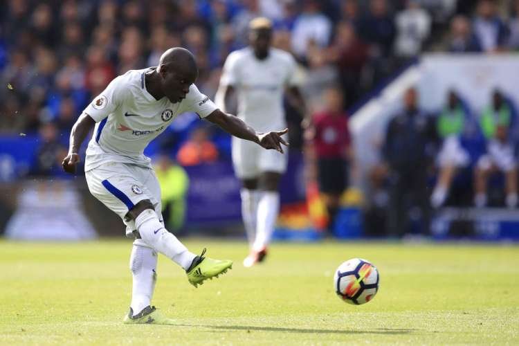 Chelsea's Kante shoots on target against Leicester