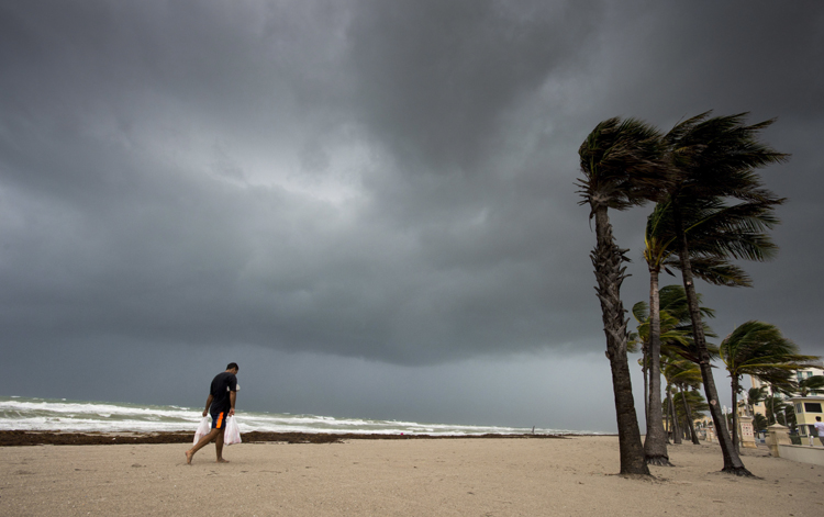 Tropical storm winds, rain increase as Irma moves north