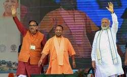 Prime Minister Narendra Modi (R), Uttar Pradesh Chief