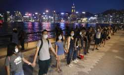 Hong Kong protesters form human chains to call for democracy