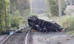 Porsche SUV plunges onto train tracks, burst into flames; 2