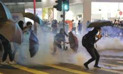 Pro-China supporter set on fire amid chaos in Hong Kong