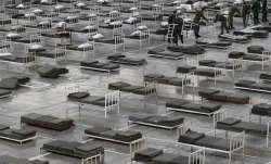 In this March 24, 2020, photo, Serbian soldiers set up beds