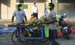Indians shop for vegetables during lockdown in Bangalore, India, Thursday, March 26, 2020. The unpre