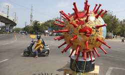 Police placed a virus themed globe at a traffic signal