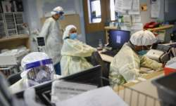 In this Monday, April 20, 2020 file photo, emergency room doctors and nurses wear personal protectiv