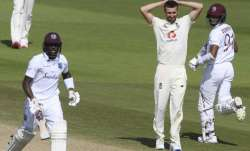 England's Mark Wood, center, reacts as West Indies'