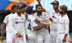 India's Mohammed Siraj, centre, is congratulated by