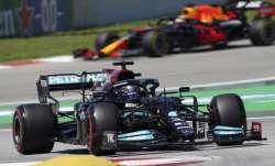 Mercedes driver Lewis Hamilton of Britain takes a curve