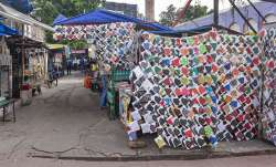 Facemasks for sale at a roadside stall as the street wears