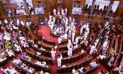 New Delhi: Members protest in the well of the Rajya Sabha