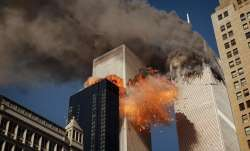 Smoke billows from one of the towers of the World Trade