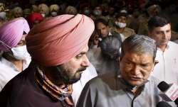 Congress leaders Harish Rawat and Navjot Singh Sidhu brief