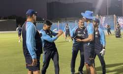 MS Dhoni (second from left) with Team India coaching staff on Sunday.