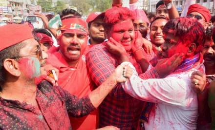 Samajwadi Party supporters celebrate their success in