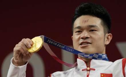Shi Zhiyong of China celebrates on the podium after winning