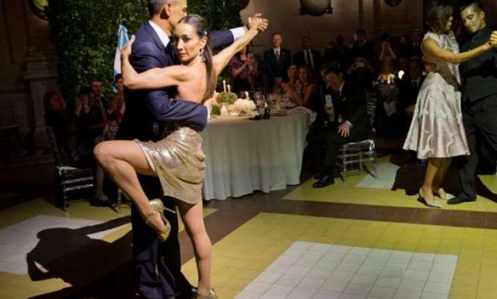 President Barack Obama and first lady Michelle Obama dance