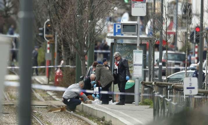 Investigators collect evidence near a tram track in