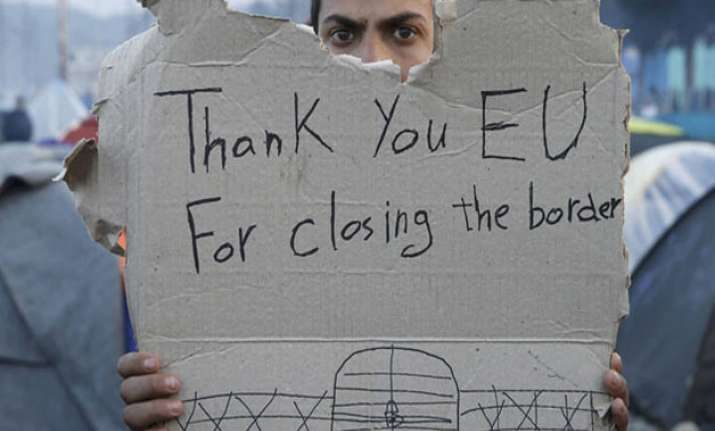 "A refguee holds message, ""Thank you EU for closing the"