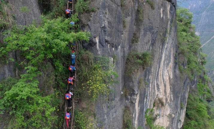 Children climb 2,500 foot ladder to go to school