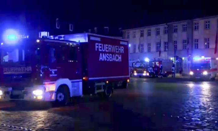 Fire trucks and ambulances stand in the city center of
