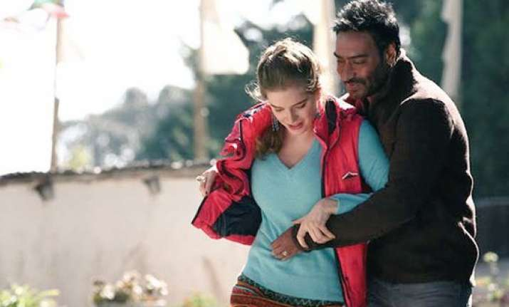 What convinced Ajay Devgn to kiss on screen in